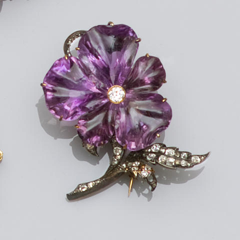 A carved amethyst and diamond flower brooch
