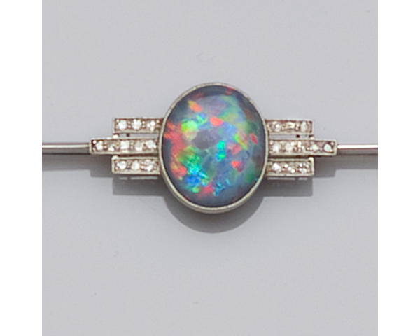 An Art Deco black opal and diamond bar brooch