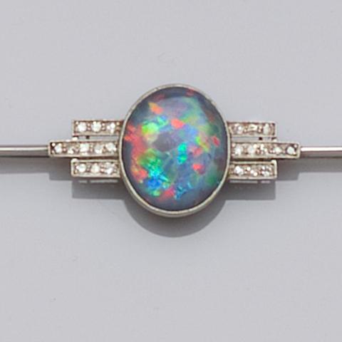 An Art Deco black opal and diamond bar brooch