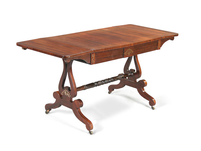 A North European early 19th century mahogany and brass-inlaid sofa table