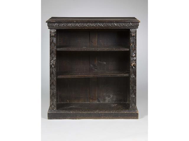 An oak Victorian carved dwarf open bookcase