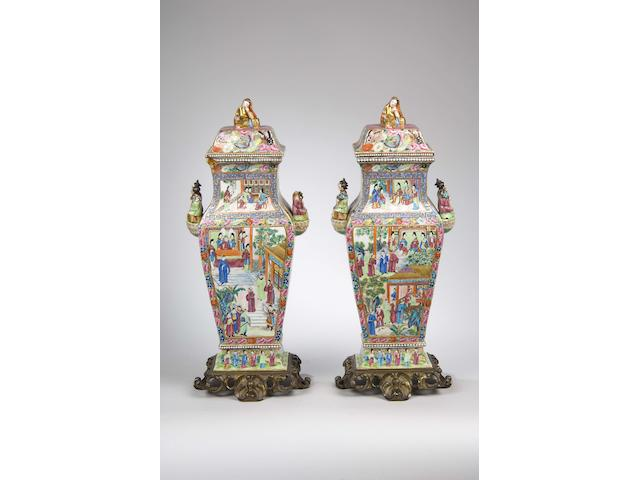 A fine pair of Canton famille rose squared baluster vases and covers mid 19th Century