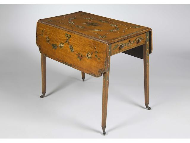 A late 19th century satinwood and polychrome decorated Pembroke table