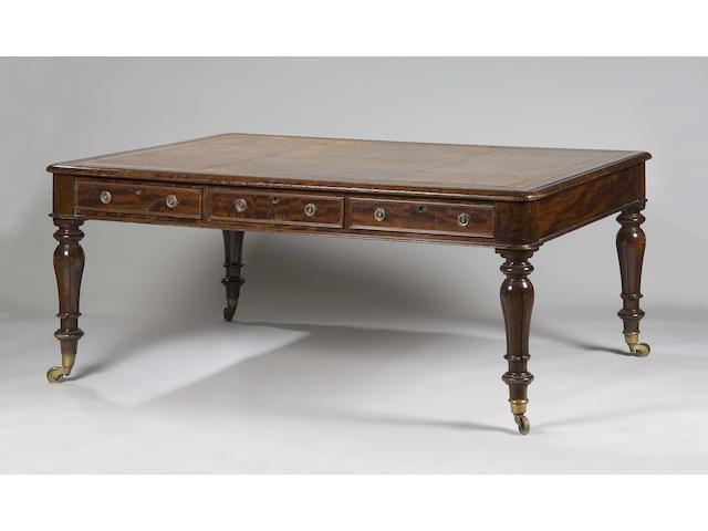 A George IV mahogany partners library table