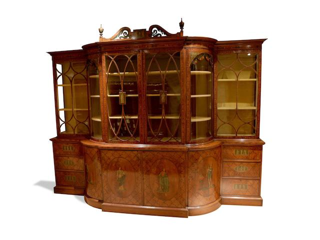 An impressive large Edwardian satinwood and polychrome decorated breakfront bookcase circa 1900