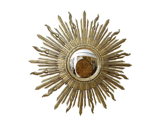 An early 20th century large carved giltwood sun burst convex mirror circa 1919