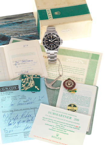 Rolex. A fine and rare stainless steel automatic calendar bracelet watch with punched Guarantee Certificate, original bill of sale, Rolex Submariner booklet, 660 ft/200m anchor, triplock crown swing tag, original folded link bracelet, outer box lid with 1680 decal, 1680 case back sticker and Submariner 200 cigarette cardRef:1680, Case No.2652874, Made in 1970, Sold 22 January 1974