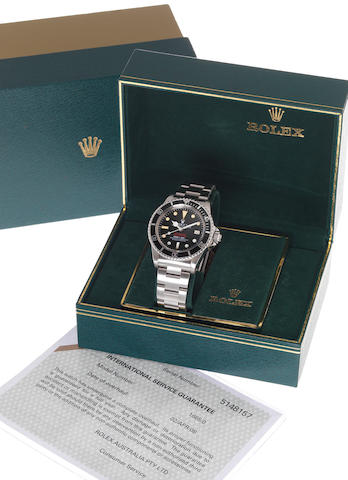 Rolex. A fine and rare stainless steel automatic wristwatch with gas-escape valve, fitted Rolex box stainless steel Oyster bracelet and Rolex service Guarantee papers dated April 2nd 2008Ref:1665 'Double-Red Sea-Dweller' Mk IV, Case No.5148157. circa 1975