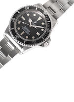 """Rolex. A fine and rare stainless steel automatic wristwatch with gas-escape valve, fitted Rolex box stainless steel Oyster bracelet and Rolex service Guarantee papers dated April 2nd 2008Ref: 1665 """"White Sea-Dweller"""" Mk IV, Case No.6018465,  Made in 1979, Sold in 1980"""
