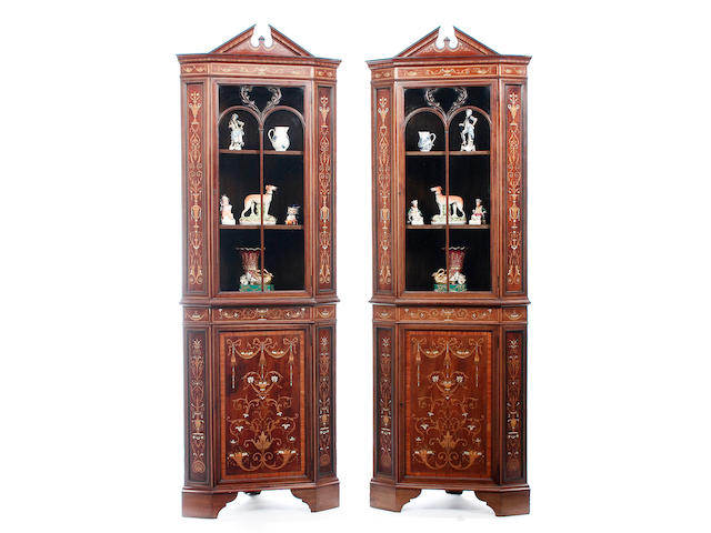 A pair of late Victorian or Edwardian mahogany, marquetry and satinwood banded corner display cabinets,