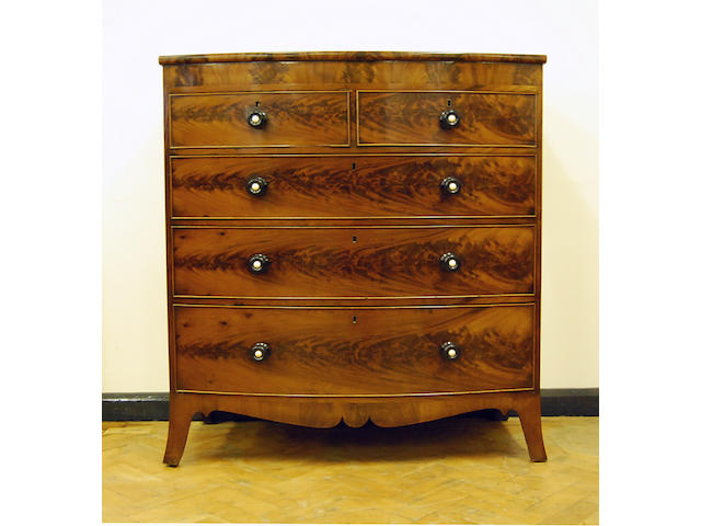 An early Victorian mahogany and figured mahogany bow-front chest of drawers