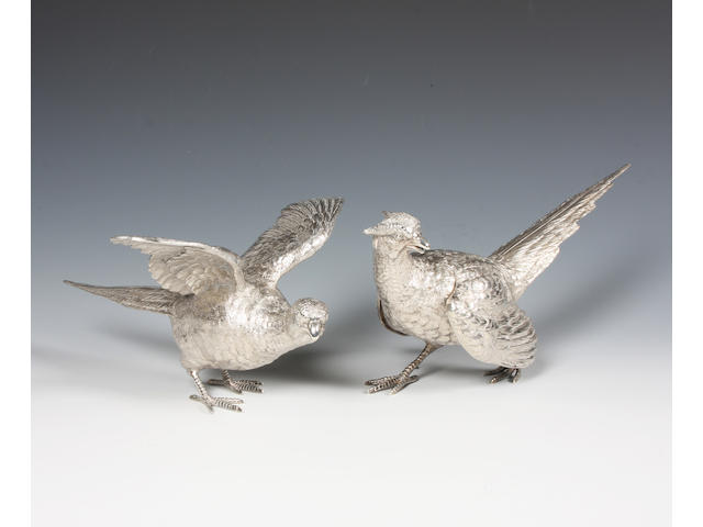 A pair of silver dining table ornaments modelled as pheasants By C J Vander, London, 1973,  (2)