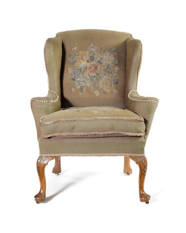 A George I carved walnut framed Wing Armchair