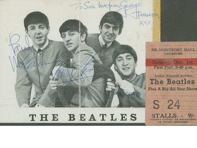 An autographed Beatles publicity photograph and concert items,