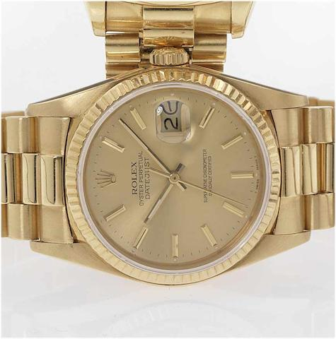 Rolex. An 18ct gold automatic centre seconds calendar bracelet watchDatejust, 1985