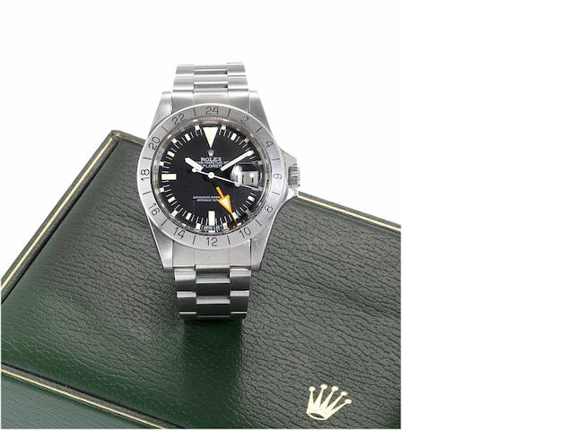 Rolex. A fine stainless steel centre seconds automatic wristwatch with special 24-hour bezel and orange hand together with fitted box Explorer II, Ref:1665, Case No.8096442, Made in 1982.