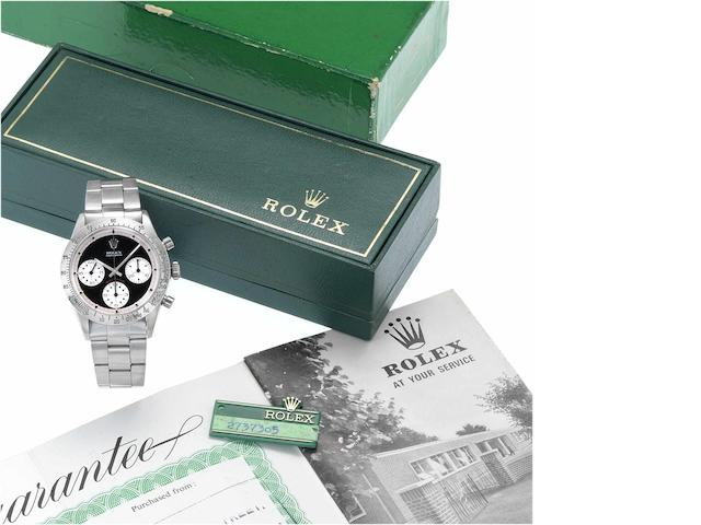 "Rolex. A fine and rare stainless steel chronograph wristwatch together with original Rolex guarantee, swing tag, fitted box and instructions Cosmograph Daytona, ""Paul Newman"", Ref.6262, Case No. 2737305, 1969, Sold 7th December 1971"
