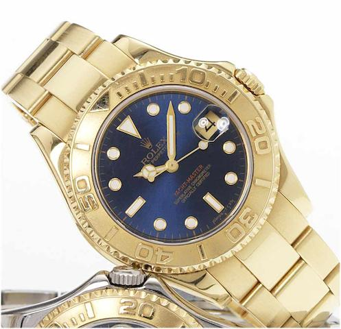 Rolex. A fine lady's 18ct gold mid size automatic centre seconds calendar bracelet watch Yacht Master, 1996