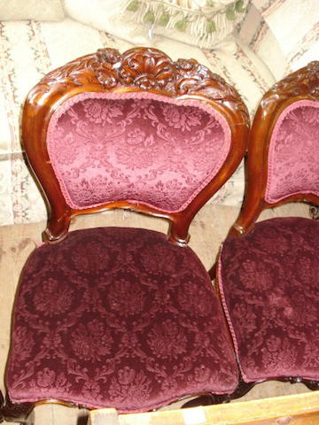 A set of eight carved mahogany dining chairs,