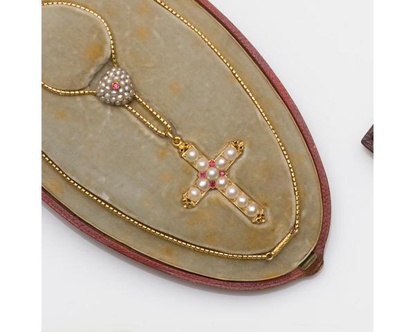 A mid-Victorian gold half pearl cruciform pendant