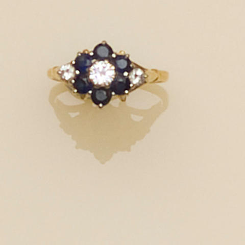 A sapphire and diamond flowerhead cluster ring