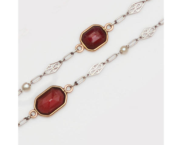 A garnet and pearl set long chain