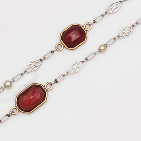 A garnet and pearl set long chain