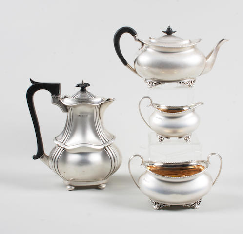 A late 19th/early 20th century silver three piece tea set By H. Atkin, Sheffield, 1899-1903,  (4)