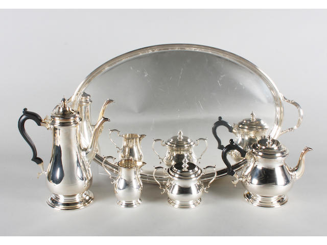 A silver four piece tea set and a twin handled tray By C J Vander Ltd, Sheffield, 1990-91,  (5)