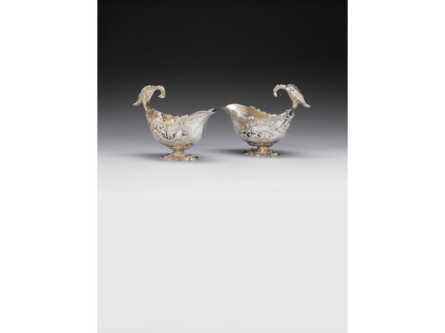 A pair of George III silver rococo revival sauce boats, by William Pitts, London 1814, also stamped with French tax mark,  (2)