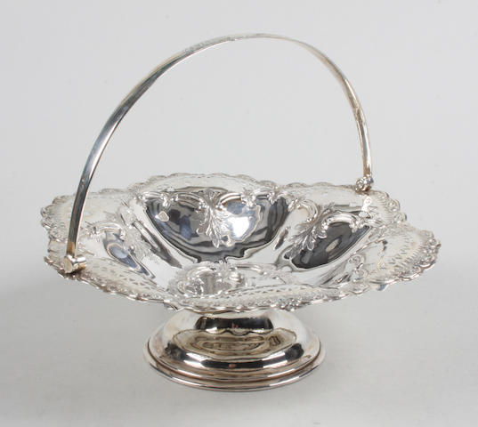 An Edwardian  silver swing handled basket By J. Round,  Sheffield,  1902,