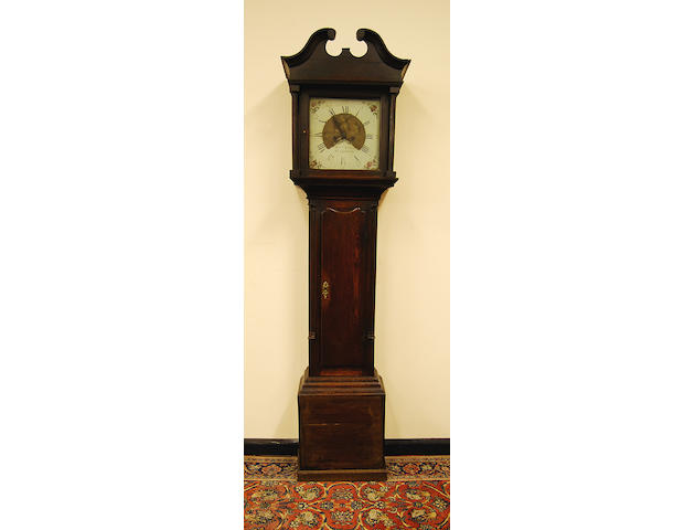 A late George III oak-cased painted dial eight day longcase clock, circa 1800 'Moses Evans, Llangerniew'