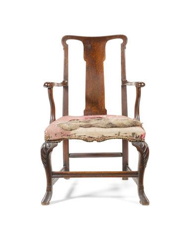 A Queen Anne walnut open Armchair