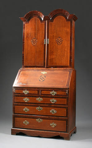 An oak, mahogany-crossbanded and inlaid dome-topped bureau cabinet, early 18th Century and later