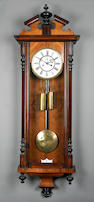 A late 19th Century walnut-cased two-weight driven 'Vienna' wall clock Anonymous, circa 1890 sold with two weights plus pendulum