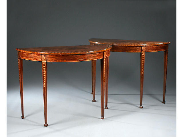 A pair of Irish George III mahogany, crossbanded and sycamore marquetry demi-lune Pier Tables in the manner of William Moore of Dublin