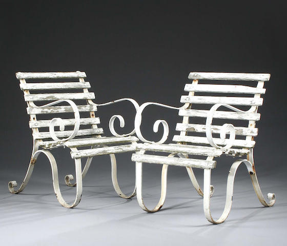 A pair of Victorian white painted garden open armchairs