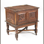 A late 19th/early 20th century carved oak box on stand