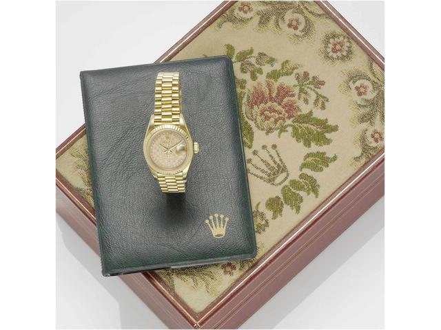 Rolex. A fine lady's 18ct gold diamond set automatic centre seconds calendar bracelet watch with fitted boxDatejust, Ref:69178, Sold May 18th 1984