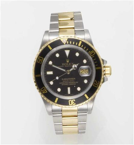 Rolex. A fine stainless steel and gold automatic centre seconds calendar bracelet watch with fitted box and papers  Submariner, Ref:16803, Case No.9672732, 1986 circa