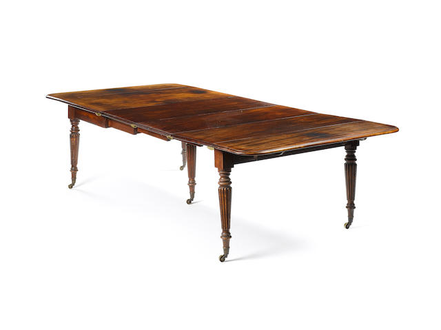A George IV mahogany concertina-action Dining Table in the manner of Gillows