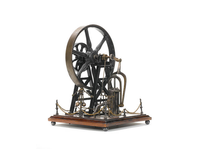 A mid 19th century single cylinder vertical over crank A-frame stationary engine