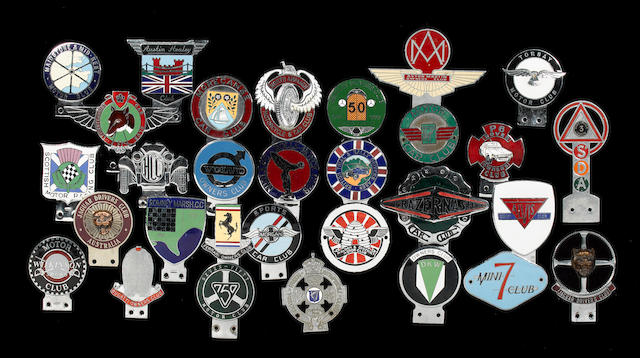 A large collection of motoring badges and plaques,