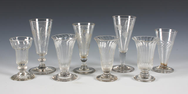 Three engraved dwarf ale glasses, a wrythen bowl dwarf ale glass and four jelly glasses