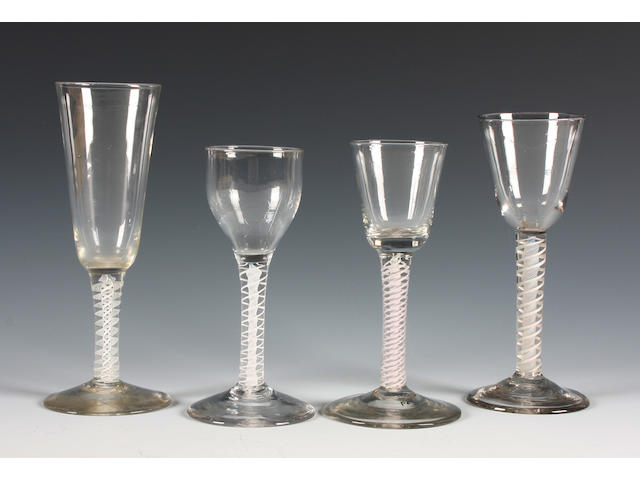 Four opaque-twist wine glasses