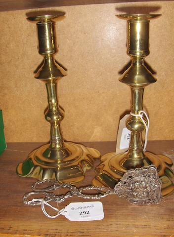 A pair of late Georgian brass knopped candlesticks
