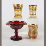 Three Bohemian glass beakers and a ruby glass tazza Mid-late 19th Century