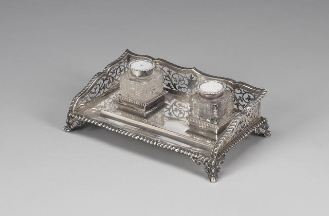 An Edwardian silver desk set, by J. Rogers, Sheffield 1909 and an inkstand. (4)