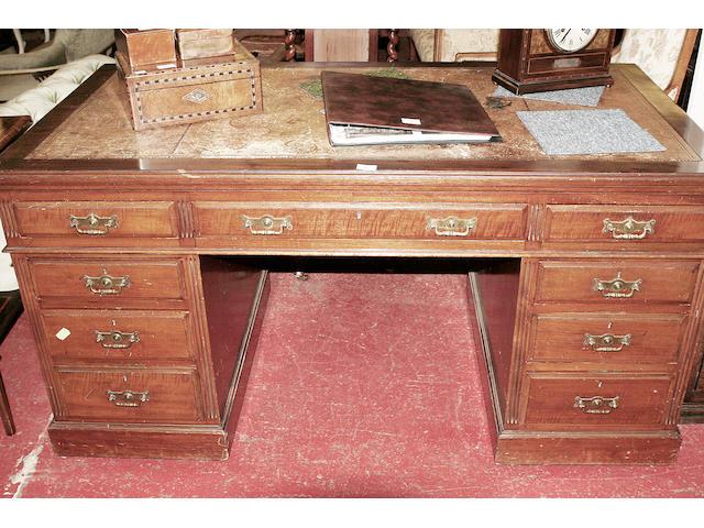 A late Victorian mahogany pedestal desk
