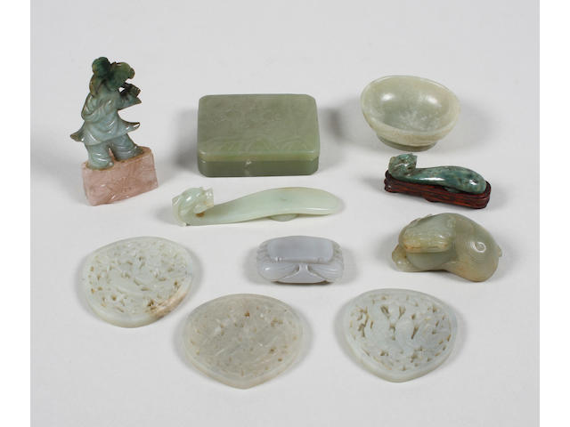 A group of carved jade items